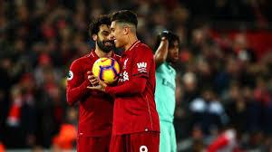 """Firmino : """"Merci de me donner ce pénalty"""". Salah : """"De rien, c'est l'arbitre qui vient de me faire ce cadeau""""."""